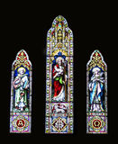 kyrkligt exponeringsglas befläckte tre fönster royaltyfria foton