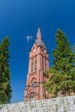 Kyrkligt torn i Nurmes, Finland Arkivfoto
