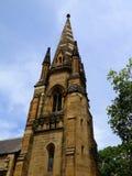 Kyrkligt torn och tornspira Arkivfoto