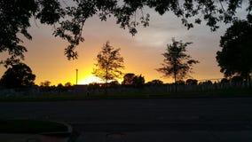 Kyrkogård på solnedgången Arkivfoton