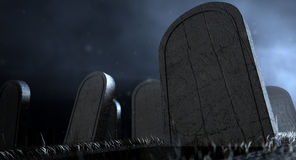 Kyrkogårdgravstenar på natten Royaltyfri Foto
