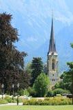 Kyrktaga de schweiziska fjällängarna av dåliga Ragaz Royaltyfri Fotografi
