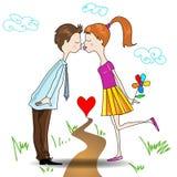 Kyssa för pojke och för flicka Arkivbilder