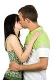 kyssande barn för par Fotografering för Bildbyråer