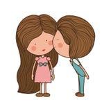 Kyssande flicka för pojke i kind Arkivbild