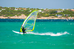 Windsurf. Guy having fun with his windsurf in Capo Testa - Watersport with strong wind - Sardinia (08/2009 stock image