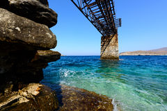 Kythnos Loutra iron quay. Old gantry at Loutra, Kythnos, Greece for loading iron ore from the mines Royalty Free Stock Image