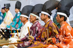 Kyudo Men with Fans Stock Photo