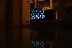 Lámpara con una vela dentro en una tabla Imagen de archivo libre de regalías