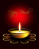 Lámpara de aceite con saludos del diwali sobre fondo oscuro