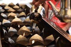 Lámpara de aceite en el templo, Tailandia Foto de archivo libre de regalías
