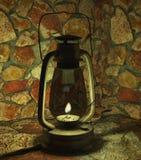 Lámpara de aceite en una cueva de piedra Fotografía de archivo libre de regalías