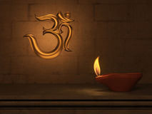 Lámpara de aceite tradicional india con símbolo de OM Imagen de archivo libre de regalías