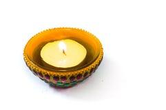 Lámpara de Diya aislada en blanco Imagen de archivo