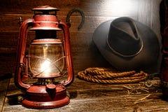Lámpara de keroseno en granero del oeste americano del vaquero del rodeo Fotografía de archivo libre de regalías