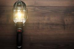 Lámpara de mano en fondo de madera Fotografía de archivo