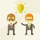 Lámpara del concepto de la idea, socios del hombre de negocios Fotos de archivo libres de regalías