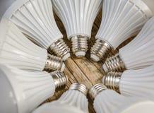 Lámpara del LED en un fondo de madera, Imagenes de archivo