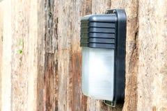 Lámpara en la pared de madera Imagen de archivo libre de regalías