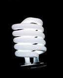 Lámpara fluorescente espiral aislada en negro Fotografía de archivo libre de regalías