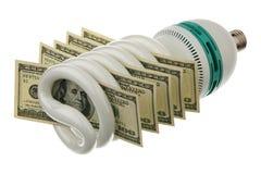 Lámpara fluorescente y dólar americano imagen de archivo