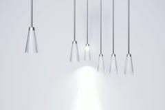 Lámpara que brilla intensamente en un fondo ligero Fotos de archivo libres de regalías