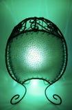 Lámpara verde de la vela con el fondo verde Imagenes de archivo