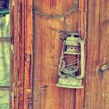 Lámpara vieja en una pared Fotografía de archivo