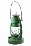 Lámpara vieja o del vintage de huracán en el fondo blanco, corrosión material del material de la lámpara Imagen de archivo