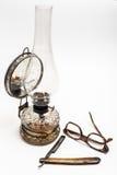 Lámpara y maquinilla de afeitar Foto de archivo