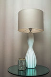 Lámpara y vela modernas Fotografía de archivo libre de regalías
