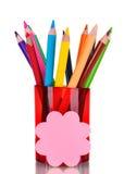 Lápices brillantes en sostenedor rojo Imágenes de archivo libres de regalías