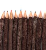 Lápices coloreados cubiertos corteza Fotografía de archivo libre de regalías