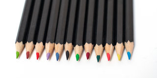 Lápices coloreados de la escuela empilados Fotos de archivo