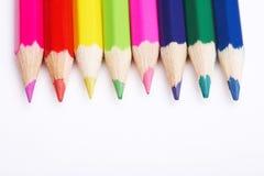 Lápices coloreados en blanco Imagen de archivo