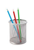 Lápices coloreados en cesta Imagen de archivo libre de regalías