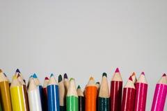 lápices coloreados en el fondo blanco Fotografía de archivo