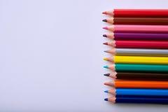 lápices coloreados en la hoja blanca Imágenes de archivo libres de regalías