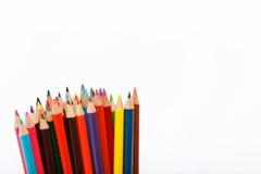 Lápices coloreados en un blanco. Imagen de archivo libre de regalías