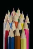 Lápices coloreados en un fondo negro Fotos de archivo libres de regalías