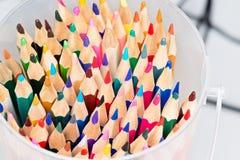 Lápices coloreados en un rectángulo Fotos de archivo libres de regalías