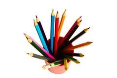 Lápices coloreados en un vidrio Fotos de archivo libres de regalías