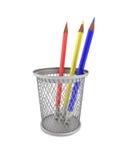 Lápices coloreados en una cesta Imagen de archivo libre de regalías