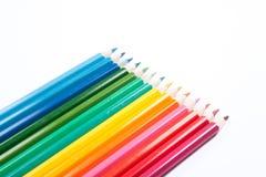 Lápices coloreados en una fila Foto de archivo