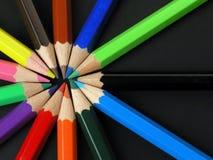 Lápices coloreados en una fila Imágenes de archivo libres de regalías