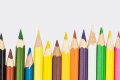 Lápices coloreados en una fila Imagen de archivo