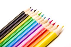 Lápices coloreados en una línea Fotos de archivo libres de regalías