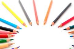 Lápices coloridos en el fondo blanco Imagenes de archivo