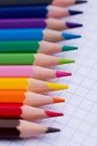Lápices coloridos - papel de la escuela Imágenes de archivo libres de regalías