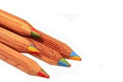 Lápices con cuatro colores que corren con cada uno Foto de archivo libre de regalías